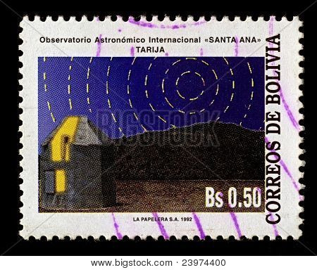 "BOLIVIA-CIRCA 1993:A stamp printed in Bolivia shows image of Observatory ""Canta Ana"", Tarija. An observatory is a location used for observing terrestrial and/or celestial events, circa 1993."