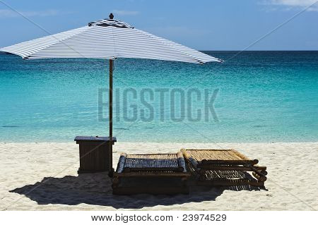 Beach Scene With Lounger And Umbrella