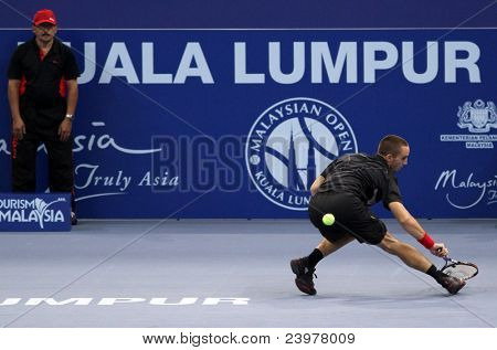 BUKIT JALIL, MALAYSIA - OCT 01: Serbia's Viktor Troicki hits a return in this Malaysian Open semi-final match with Cyprus' Marco Baghdatis on October 01, 2011 in Putra Stadium, Bukit Jalil, Malaysia.