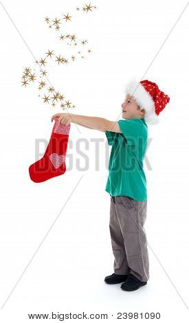 Joyful Child Releasing Stars From Christmas Stocking