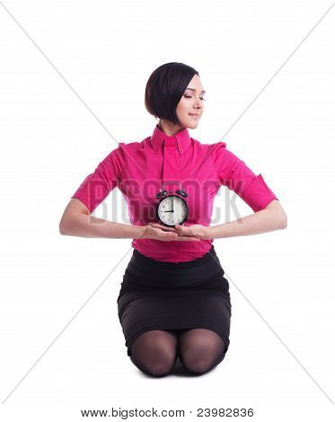 business woman relax in yoga pose with clock