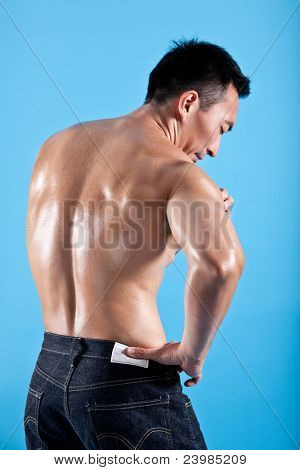 Young healthy man suffering from shoulder pain