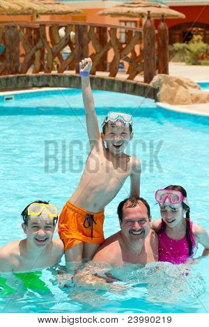 Kids and father in pool