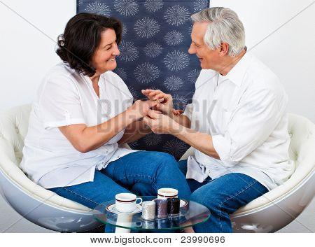 sweet senior couple in love drinking coffee