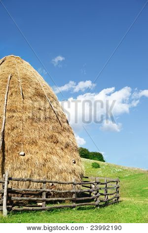 Hay stack under blue sky