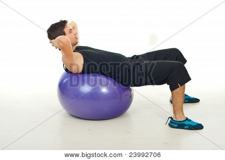 Man Doing Abs On Pilates Ball