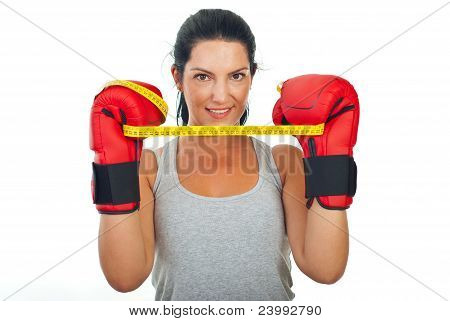 Woman Holding Centimeter Between Gloves