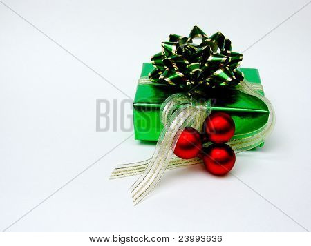 Green Christmas gift with red baubles