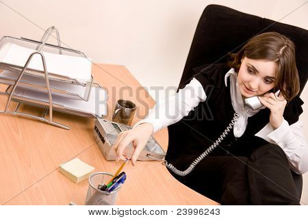 Businesswoman Calling By Phone At Office