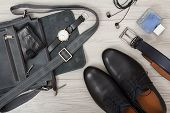 Leather Shoulder Bag For Men With Wallet And Wristwatch On It, Pairs Of Black Leather Mens Shoes, B poster