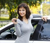 foto of car key  - Pretty girl showing the car key - JPG