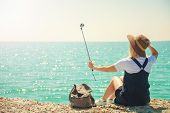 Pretty Young Woman Tourist Takes Selfie Portrait At The Seashore On A Sunny Day Girl Takes Photo For poster