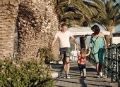 Mother And Father With Son Walk At Beach Palms. Summer Vacation Of Happy Family. Love And Trust As F poster