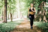 Running Woman On Park. Female Runner Jogging During Outdoor Workout In A Park. poster