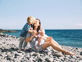 Family Holiday On Tenerife, Spain. Mother With Children Outdoors On Ocean. Portrait Travel Tourists  poster
