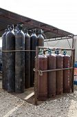 stock photo of gases  - The storage of oxygen and acetylene gases at work site - JPG