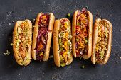 Hot Dogs With A Sausage On A Fresh Rolls Garnished With Mustard And Ketchup And Served With Differen poster