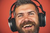 Pleasure, Leisure, Music, Listening, Relax And Technology Concept - Happy Man With Beard Enjoying Mu poster