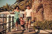 Happy Family Spend Time Together, Urban Background. Parents With Son Walking Near Palm Trees, Happy  poster