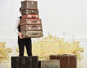 Butler And Service Concept. Macho, Elegant Porter Carries Heavy Pile Of Vintage Suitcases. Man With  poster