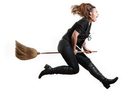 foto of banshee  - A modern day witch flying on her broomstick on white - JPG