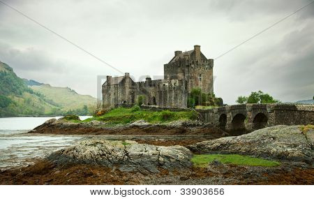 Eilean Donan castle on a cloudy day. low tide. Highlands, Scotland. UK