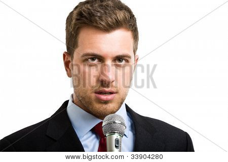 Portrait of a man speaking in a microphone. Isolated on white