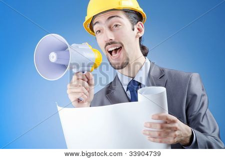Construction worker shouting via loudspeaker