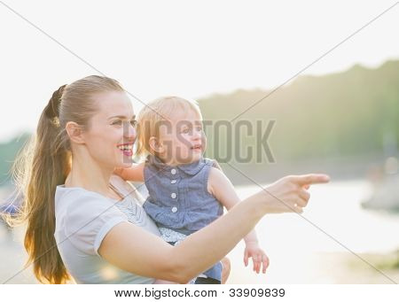 Mother Showing Something To Baby