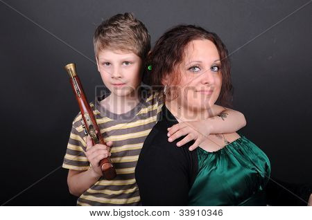Woman And Boy In The Studio
