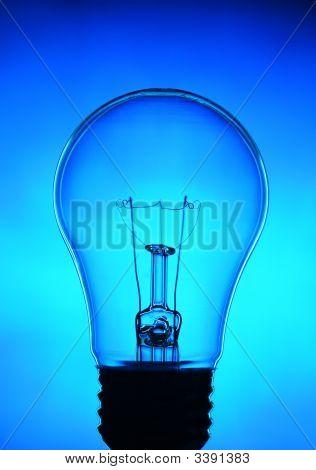 Un-Lit Light Bulb On Blue Background