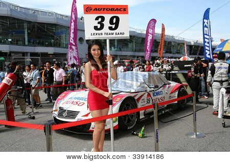 SEPANG - JUNE 10: The Denso Kobelco SC430 car of Lexus Team SARD waits on the starting grid on race day at the Autobacs SUPER GT Series Rd 3 on June 10, 2012 at the Sepang Int. Circuit, Malaysia.