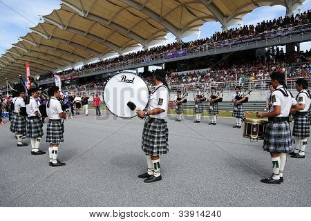 SEPANG - JUNE 10: The St. John's Alumni Pipe Band performances songs using bag-pipes at the 2012 Autobacs SUPER GT Series Round 3 on June 10, 2012 at the Sepang International Circuit, Malaysia.