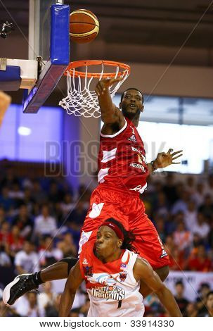 KUALA LUMPUR - JUNE 02: Vincent Crews (Beermen) jumps above Tiras Wade (Dragons) to block his lay up shot in a playoff match in the ASEAN Basketball League on June 02, 2012 in Kuala Lumpur, Malaysia.
