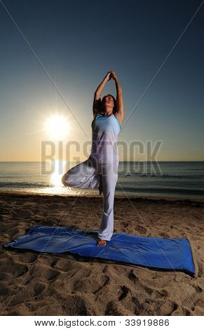 Yoga On Beach With Sunrise