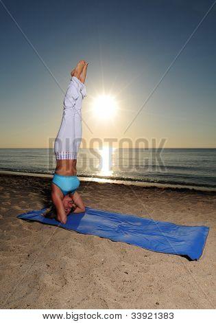 Yoga Handstand On Beach