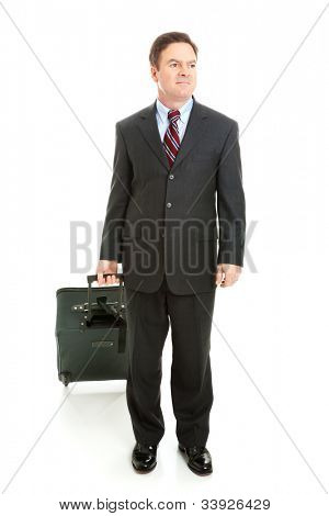 Businessman traveling with his suitcase.  Full body isolated view on white background.
