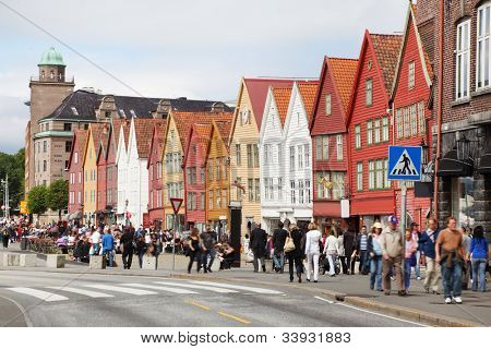 BERGEN - JUNE 27: People at Hanseatic Bryggen on JUNE 27, 2011 in Bergen, Norway. Part of Bryggen buildings were destroyed in fire in 1955. Remaining pulp is used to souvenir shops, cafes and museums.