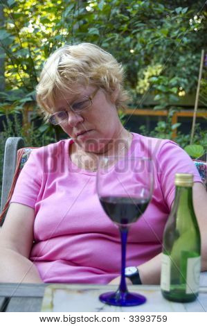 Elderly Woman Falling A Sleep After Drinking Wine