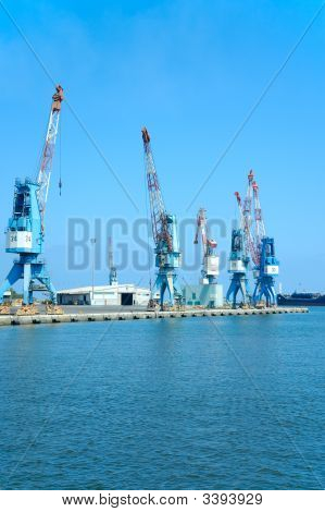 Cranes On A Cargo Pier