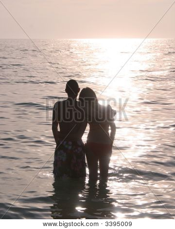 Boy Girl Standing In Water At Beach Ii
