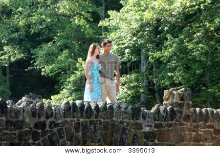 Teenage couple standing together on