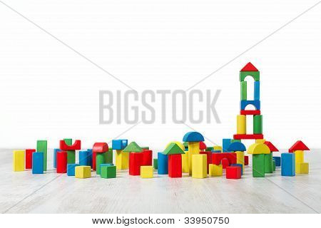 Building Blocks Toy Over Floor In White Empty Interior