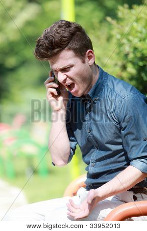 Young Man Angry On Telephone