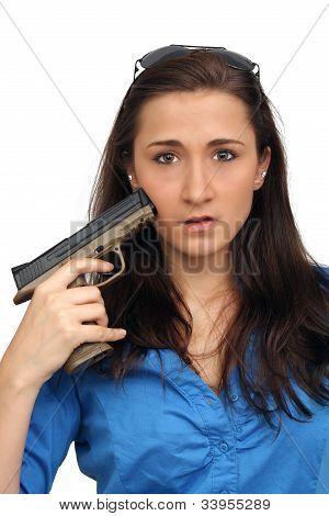 Beautiful Brunette With A Handgun