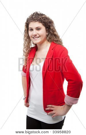 Young cute teenage girl with long curly hair.
