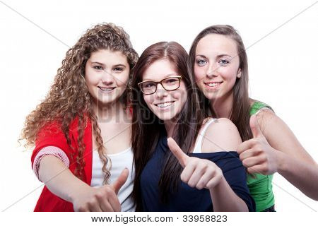 Three young women isolated over pure white background.