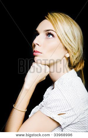Thoughtful Businesswoman On Black Background