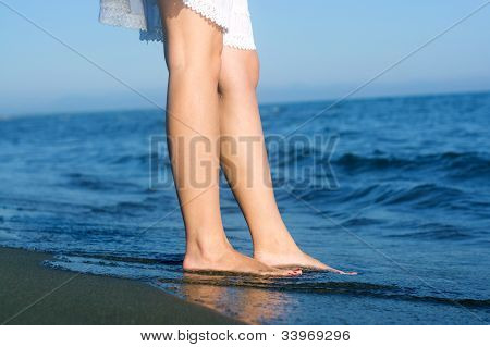 Girls legs at the beach