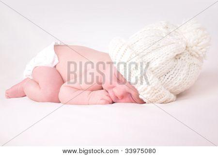 Little Newborn Baby Sleeping on White Background